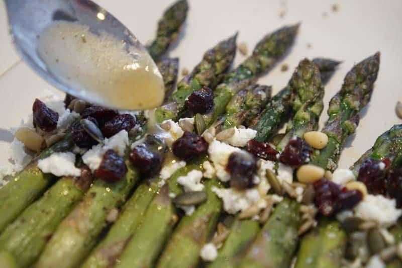 vinaigrette dressing on asparagus salad
