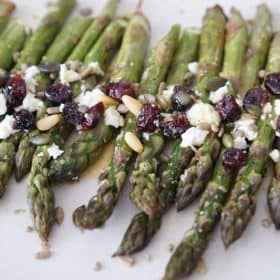 roasted asparagus salad with cranberries, feta, pine nuts and dressing