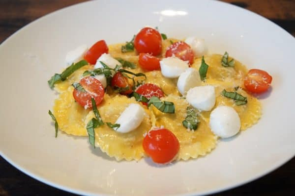 Ravioli with tomato, mozzarella and basil