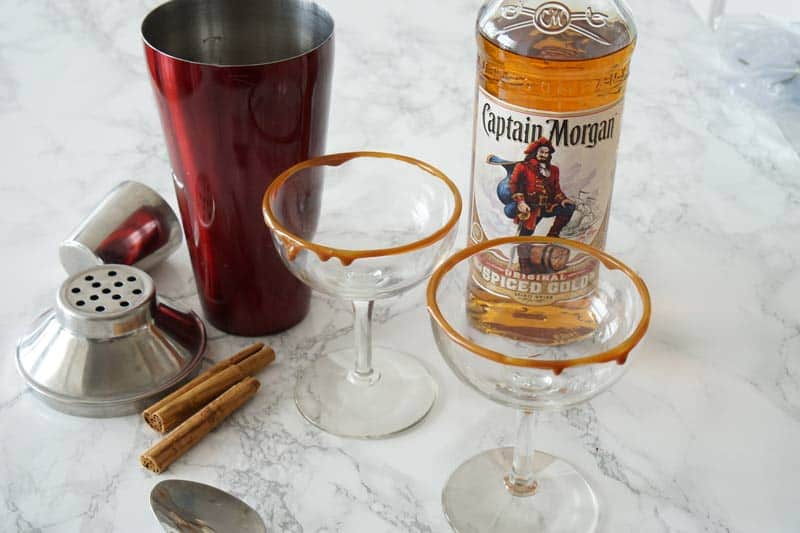 Putting together a caramel apple spiced rum cocktail