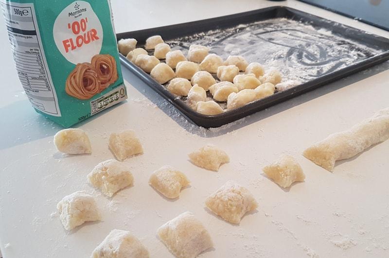 cutting gnocchi into pieces