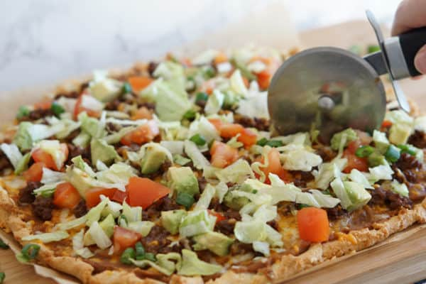 cutting taco pizza