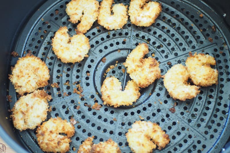 Breaded shrimp in air fryer basket