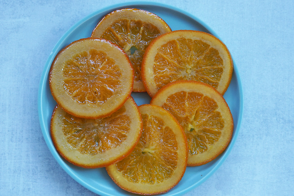 Candied Orange Slices on a plate in a circle